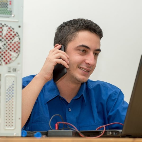 Young technician working on IT Support Issues and contact