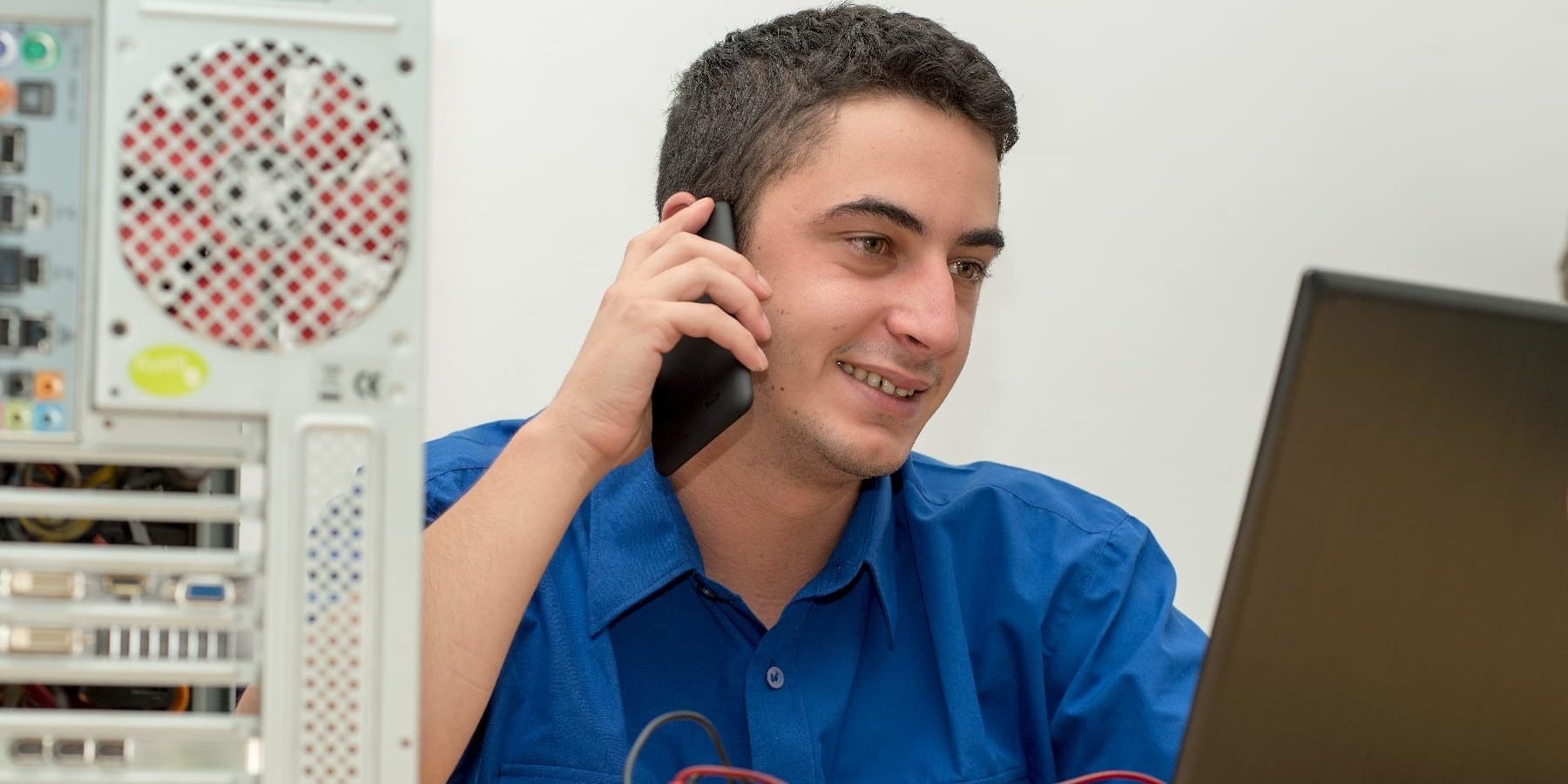 IT Support Issues Contact us Young technician working on IT Support Issues and contact IT Support Services